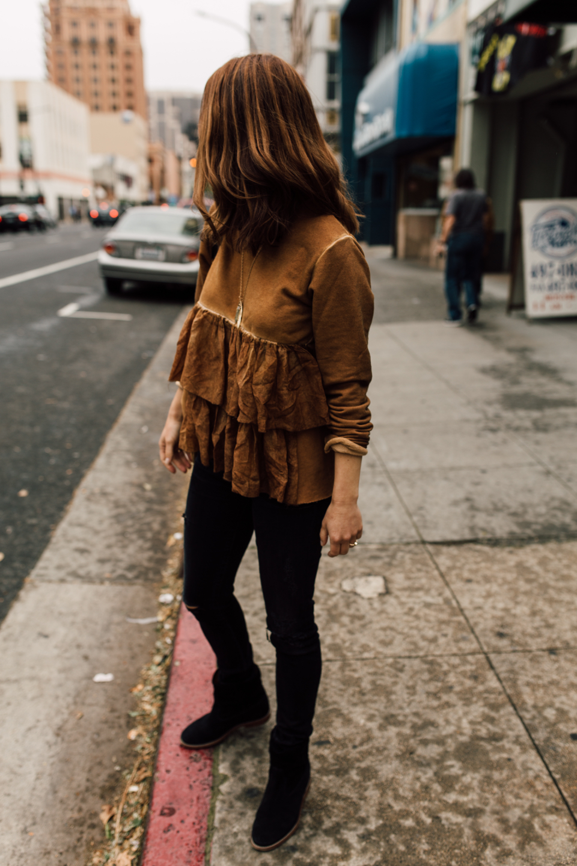 a stylish ruffled sweatshirt
