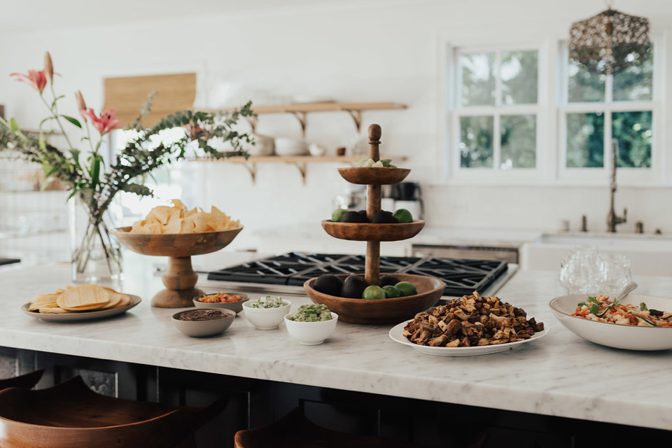 taco bar set up for a casual backyard engagement party